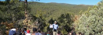 An environmental educator teaching at Sandia Mountain Natural History Center. Photo: Lowell/SMNHC.